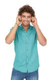 Portrait of a young man enjoying music Royalty Free Stock Images