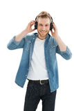 Portrait of a young man enjoying music Royalty Free Stock Image