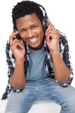 Portrait of a young man enjoying music Royalty Free Stock Photography