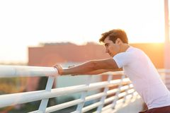Young man exercising outdoors royalty free stock photo