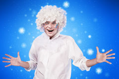 Portrait of a young man in fancy dress. On blue background Stock Images