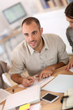 Portrait of young man filling form Stock Image