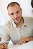 Portrait of young man filling forms Royalty Free Stock Photos