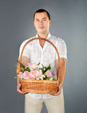 Portrait of young man with flowers Royalty Free Stock Image