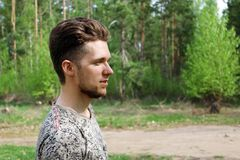 Young man outdoors. Portrait of young man in the forest Royalty Free Stock Photos