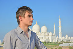 Portrait of a young man in front of mosque Stock Images