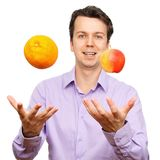 Portrait of young man with fruits. Portrait of young man with fruits isolated over white background royalty free stock photography