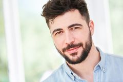 Portrait of a young man with full beard. And shirt stock photography