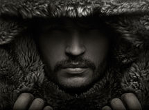 Portrait of a young man in fur hood stock photography