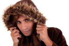 Portrait of a young man with a furry hood Royalty Free Stock Photos