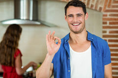 Portrait of young man gesturing in kitchen Royalty Free Stock Photo