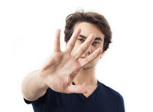 Portrait of young man gesturing stop. On white Royalty Free Stock Images