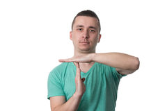 Portrait Of Young Man Gesturing Time Out Sign Royalty Free Stock Photo