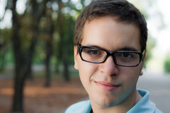 Portrait of young man in glasses stock images