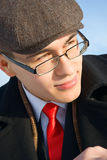 A young man in classic clothes and glasses. Stock Image