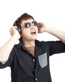Portrait of young man with glasses and headphones. Isolated on white Stock Photography