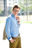 Portrait of a young man with glasses smiling Stock Image