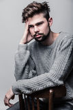 Portrait of a young man in gray pullover. Headache Stock Photos
