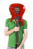 Portrait of the young man with a guitar Stock Photography