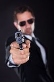 Portrait Of Young Man With Gun Stock Photography