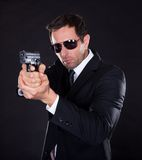 Portrait of young man with gun royalty free stock images