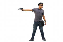 Portrait Of Young Man With Gun On White Background Stock Photo