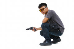 Portrait Of Young Man With Gun On White Background Royalty Free Stock Photo
