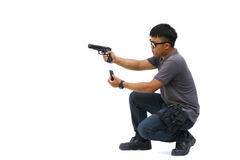 Portrait Of Young Man With Gun On White Background Royalty Free Stock Photography