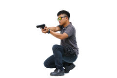 Portrait Of Young Man With Gun On White Background Royalty Free Stock Photos