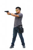 Portrait Of Young Man With Gun On White Background Stock Photography