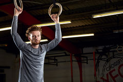 Portrait Of Young Man In Gym With Olympic Rings Royalty Free Stock Photography