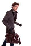 Portrait of a young man with a handbag, hasty Stock Photography