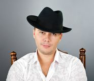 Portrait of young man in a hat Stock Image