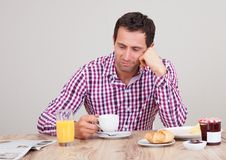 Portrait Of Young Man Having Breakfast Royalty Free Stock Photos