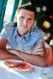 Portrait of young man having breakfast in exotic Royalty Free Stock Images