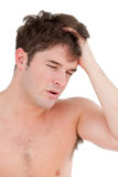 Portrait of a young man having a painful headache Royalty Free Stock Photo