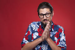 Portrait of a young man in Hawaiian shirt with hands clasped Royalty Free Stock Photo