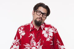 Portrait of a young man in Hawaiian shirt making a face Stock Photos