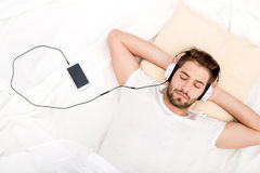 Portrait of young man with headphones Royalty Free Stock Photos