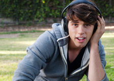 Portrait of young man with headphones listening to Stock Photos