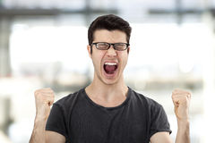 Portrait of a young man with her fist raised Stock Image
