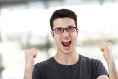 Portrait of a young man with her fist raised Royalty Free Stock Images