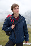 Portrait of young man hiking in the mountains Stock Photography