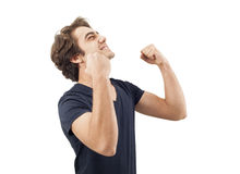 Portrait of a young man with his fist raised Stock Photos