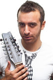Portrait from a young man with his guitar Stock Photos