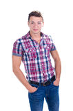 Portrait of young man with his hands in pockets Royalty Free Stock Image