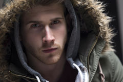 Portrait of a young man with his hood up Stock Images
