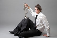 Portrait of a young man and his Trumpet Stock Images
