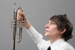 Portrait of a young man and his Trumpet Royalty Free Stock Image