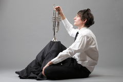 Portrait of a young man and his Trumpet Stock Photo